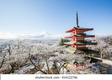 Mt. Fuji with red pagoda in winter, Fujiyoshida, Japan