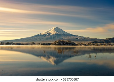 Mt Fuji reflection on water.Fujisan mountain sunrise landscape.Fuji mountain at lake Kawaguchiko and snow landscape.Japan autumn season