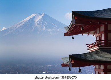 Mt. Fuji viewed from behind red Chureito Pagoda, Japan during late winter