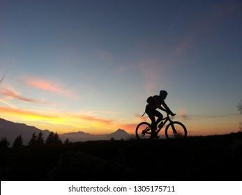 Mt. Gaisberg, Salzburg, Austria - September 21st 2018: silhouette of a mountainbiker at sunset