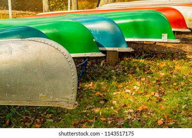 Mt. Gretna, PA, USA - October 28, 2014: In mid-autumn, canoes at the edge of a scenic lake in Lebanon County, PA.