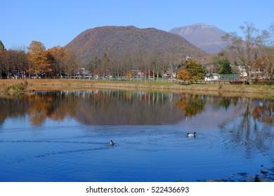 Mt. Hanare and Mt. Asama over the pond at Yagasaki Park, Karuizawa, Nagano, Japan