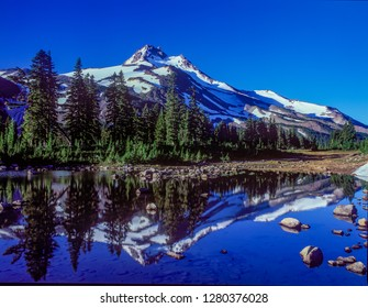 Mt Jefferson reflected in Russell lake at Jefferson park in the Mt Jefferson winderness area, Oregon