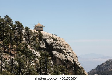 Mt. Lemmon Rock Fire Lookout cabin built in 1928, in Arizona state, USA/View of Fire Lookout Cabin on Cliff Edge at about 8800 feet Elevation/Fire lookout perches on high granite rock