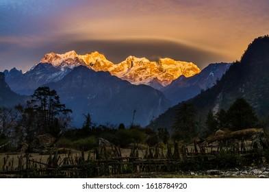 Mt. Manaslu illuminated by sun. Sunset view from Temang village in Marshyangdi river valley. Annapurna circuit trek, Nepal.