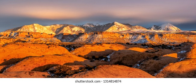 Mt. Mellenthin & Mt. Peale rise above the sand flats in Sand Flats Recreation Area, Moab, Utah.