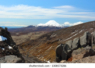 Mt Ngauruhoe and Mt Tongariro as seen across a valley from Whakapapa ski field on Mt Ruapehu, New Zealand, in spring