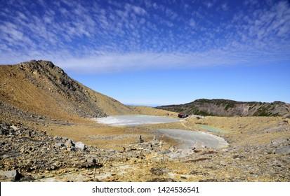 "Mt. Ontake,Nagano, Japan: Ninoike ""Volcanic lake near the top of Mt. Ontake"" covered with volcanic ash"