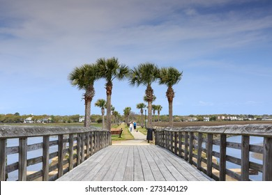 MT PLEASANT, SC - APRIL 2, 2015:  This historic wooden pier known as Pitt Street Bridge is part of a modern greenway for pedestrians and bicyclists in Mt. Pleasant, Charleston, South Carolina.