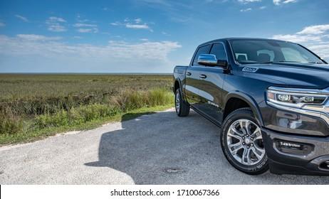 Mt. Pleasant, South Carolina / United States - 4-10-2020: 2020 Ram 1500 Laramie Longhorn, Crew Cab, Rambox, 4x2, near the marsh with blue skies.