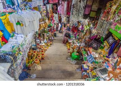 MT POPA, MYANMAR - DECEMBER 8, 2016: Trinket and souvenir sellers at the stairway to Mt Popa, Myanmar