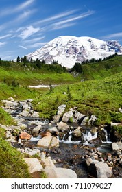 Mt. Rainier above Edith Creek under nearly cloudless blue skies in Mt. Rainer National Park, Washington, USA