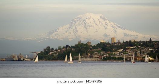 Mt. Rainier looms large over north Tacoma and Sailboats Ruston Way waterfront Nautical Landscape