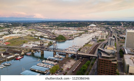 Mt Rainier stands in the background above the tide flats and the Port of Tacoma