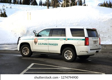 Mt Rainier, WA, USA - February 10, 2018 : Park rangers SUV parked in the Mt Rainier National Park in Washington State. Patrol the area with a SUV decorated with paintings of National Park Service Logo