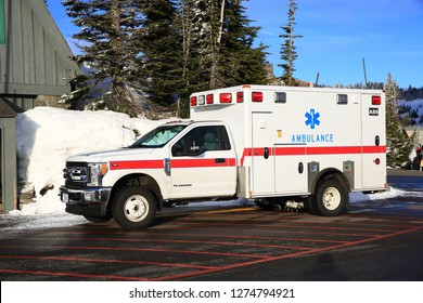 Mt Rainier, WA, USA - February 10, 2018 : Mountain rescue service truck is parking on the road at Mt Rainier National Park in Washington State.