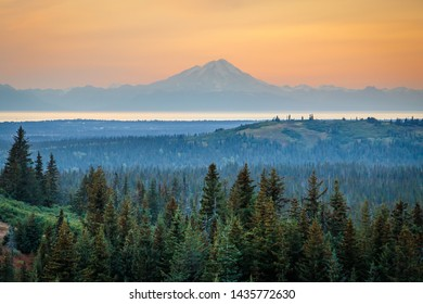 Mt. Redoubt volcano on sunset sky background, Alaska