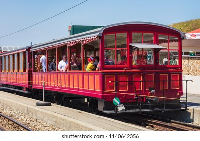 Mt. Rigi, Switzerland - July 19, 2018: people in a train standing at the Rigi-Kulm station on the summit of the mountain, which is a popular tourist destination, accessible by rack railway.