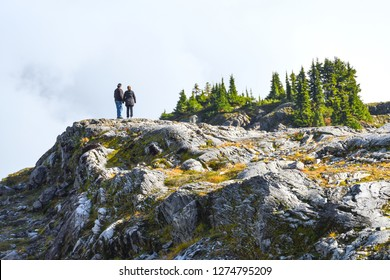 Mt Shuksan, Washington State-USA, October 09, 2016 : Middle aged couple standing on the nature background in Mt. Baker-Snoqualmie National Forest.