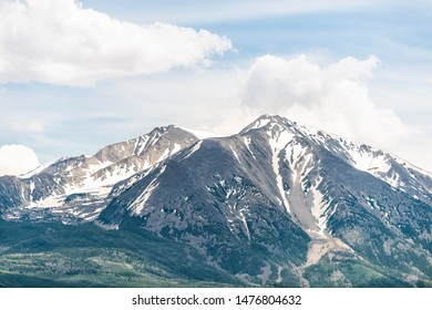 Mt Sopris view in Colorado town with closeup of snow mountain view with peak and sky in summer