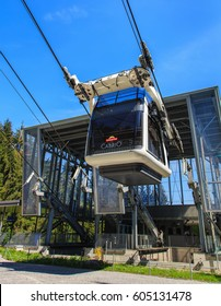 Mt. Stanserhorn, Switzerland - 8 May, 2016: a gondola of the Cabrio cable car leaving the Kalti station. Stanserhorn Cabrio is the the world's first double deck open top cable car.