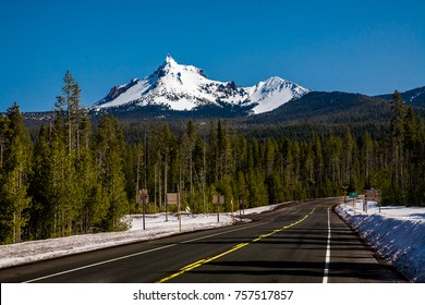 Mt Theilsen covered with snow and state Highway 230 near Diamond Lake and the summit of the Cascade mountains.