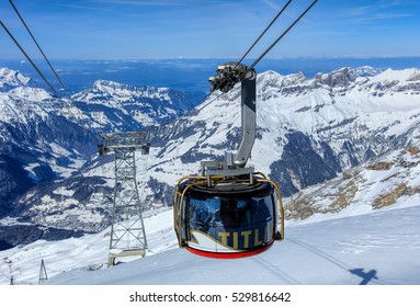 Mt. Titlis, Switzerland - 9 March, 2016: a gondola of the Rotair cable car, view from the station on the top of the mountain. Rotair gondolas make a 360 degrees turn during the five-minute trip.