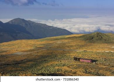 MT WASHINGTON, NH, USA - OCT 12, 2013: Mount Washington Cog Railroad at the top of Mount Washington in White Mountain in fall, New Hampshire, USA.