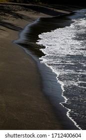Mt. Wynne black sand beach in St. Vincent