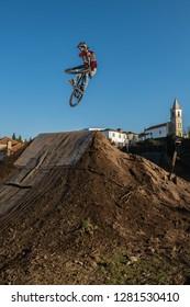MTB Bike jump over a dirt trail on a dirt track.