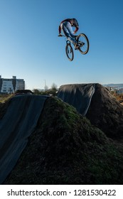 MTB Bike jump over a dirt trail on a dirt track.