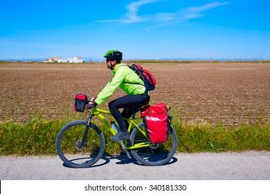 MTB Biker Bicycle touring with pannier racks and saddlebag