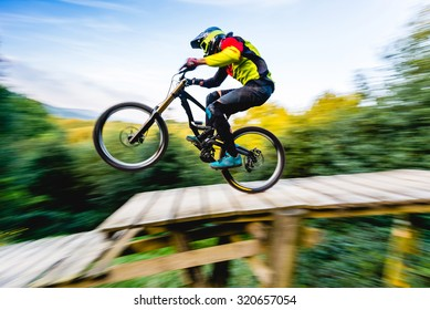 MTB rider in action. speed motion with bluried background, only bike in focus.