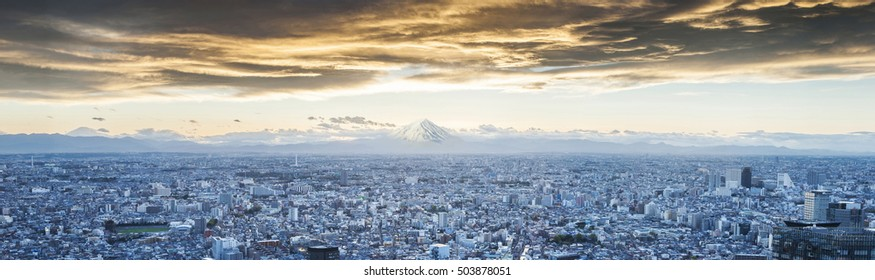 Mt.Fuji covered with snow and Japan cityscape on the sky in twilight