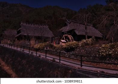 "Mt.Fuji is illuminated by moonlight of the full moon , ""Saiko Iyashino-Sato Nenba"" (Healing Village)  in Saiko Lake at night, Yamanashi, Japan."