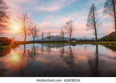 mt.Fuji in lake of Japan,Mount Fuji, Japan,with,Spring Cherry blossoms, pink flowers,Cherry blossoms or Sakura and Mountain Fuji at the river in morning
