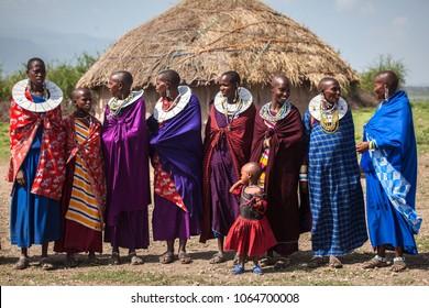 Mto wa Mbu/Tanzania - February 5 2018: A group of Maasai women smiling in front of a hut.