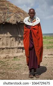 Mto wa Mbu/Tanzania - February 5 2018: A Maasai woman standing in front of a hut.
