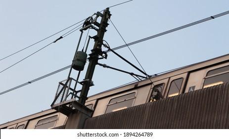 Mtr train on railway bridge and overhead lines