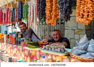 Mtskheta/ Georgia - 05.17.2019: Elderly Georgian man working in small street food stall at the square in Mtskheta