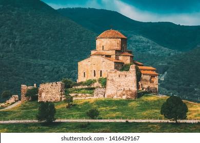 Mtskheta, Georgia. The Ancient World Heritage, Georgian Orthodox Jvari Monastery On The Spring Green Valley, Scenic Mountain Hills, Cloudy Sky Background.