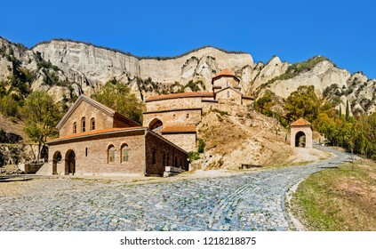 Mtskheta, Georgia. The Picturesque View Of Shiomgvime Or Shio-Mgvime Monastery, Medieval Monastic Complex In Limestone Canyon. Autumn.