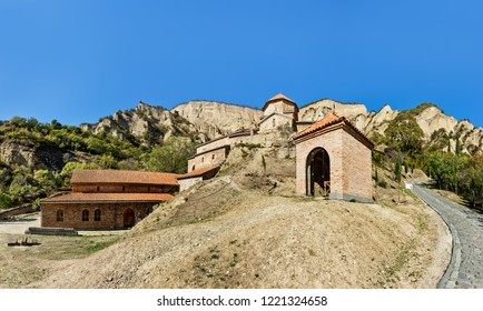 Mtskheta, Georgia. The Picturesque View Of Shiomgvime Or Shio-Mgvime Monastery, Medieval Monastic Complex In Limestone Canyon. Underground cave of St. Evagrius. Autumn.