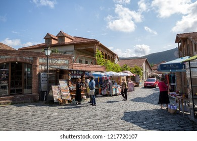 MTSKHETA, GEORGIA - SEPTEMBER 23, 2018: Tourists buy souvenirs on the street of the old town of Mtskheta near Svetitskhoveli Cathedral
