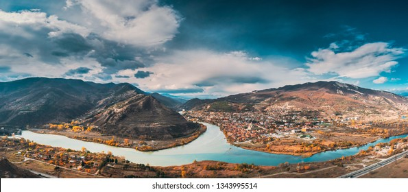 Mtskheta, Georgia. Top View Of Ancient Town Located At Valley Of Confluence Of Rivers Mtkvari Kura And Aragvi In Picturesque Highlands. Autumn Season. Panorama, Panoramic view