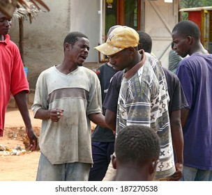 MTWARA, Tanzania - December 3, 2008: the Fish market. Unknown group of men who are communicating with each other in Mtwara, Tanzania, December 3, 2008