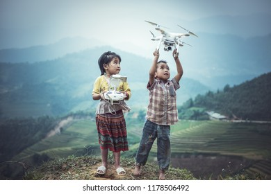 MU CANG CHAI, VIETNAM - SEP 22 , 2016 : Child operating drone flying or hovering by remote control in countryside of Vietnam