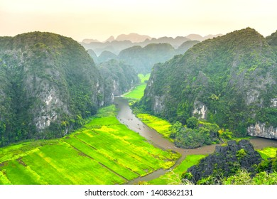 Mua Cave mountain viewpoint looking down valley, Stunning view of Tam Coc area with mountain range, rice fields and river, vietnam landscapes