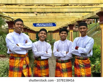 Muadzam Shah ,Malaysia - April 17th, 2018 : Portraits of happy group of handsome boy best friends together. Muslim  boy concept wearing Malay cloth.