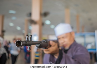 Muadzam Shah, Malaysia - August 6th, 2017 : Civilians who hold long shotguns at the arms exhibition in Politeknik Muadzam Shah, Malaysia.